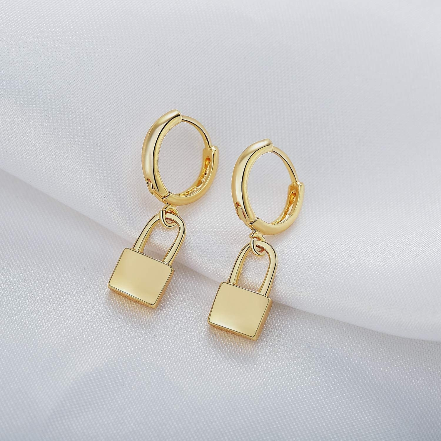 Small gold hoops with little padlocks hanging from them