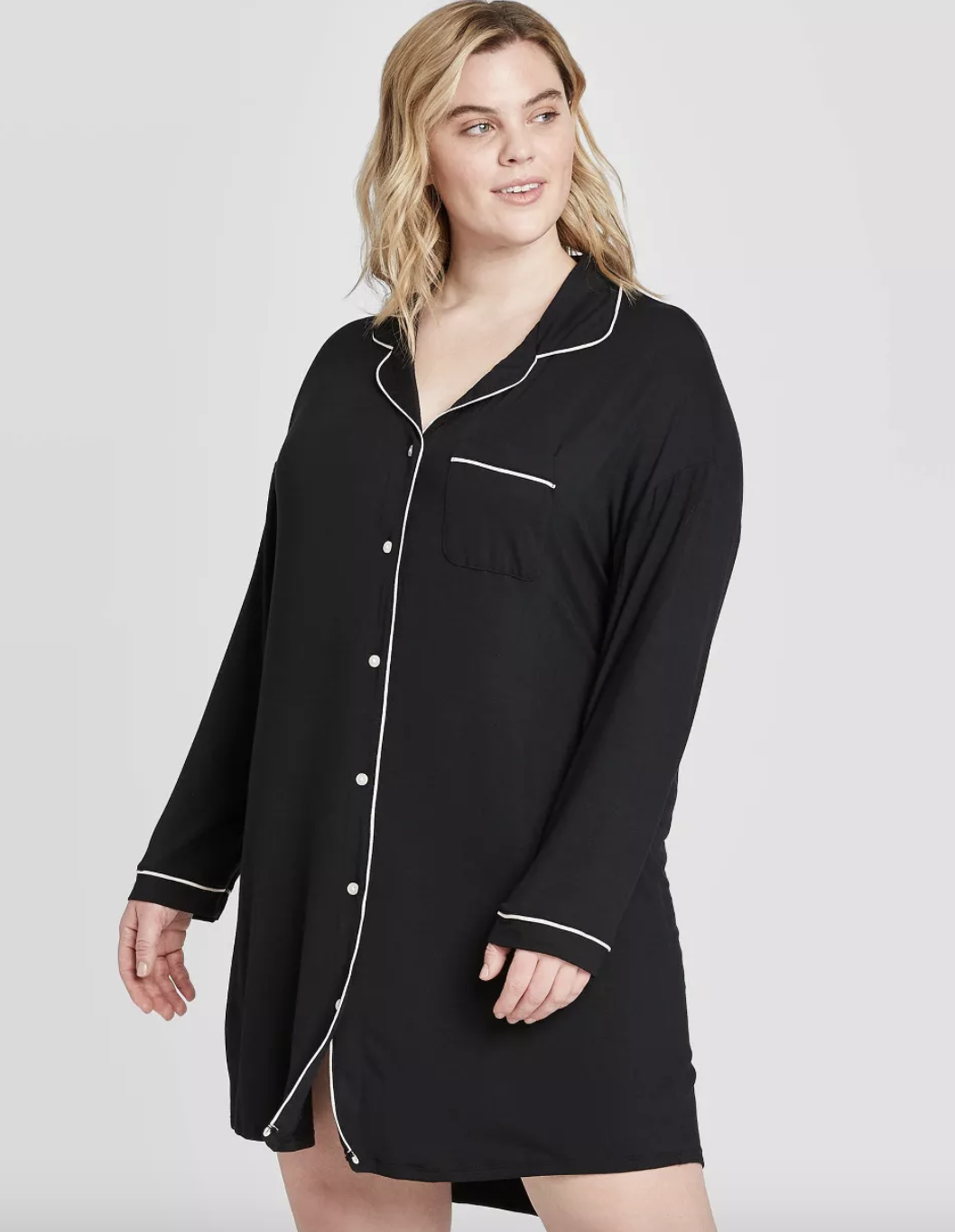 model wearing black sleeved button-down