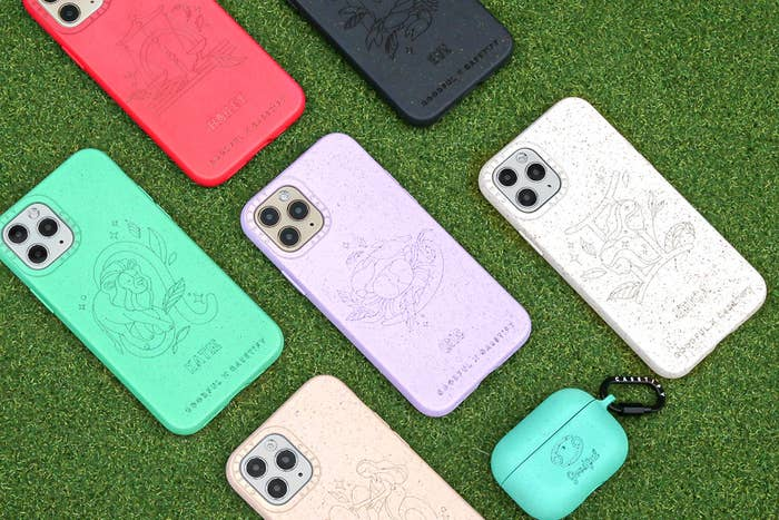 iPhone cases with astrology signs on a green background
