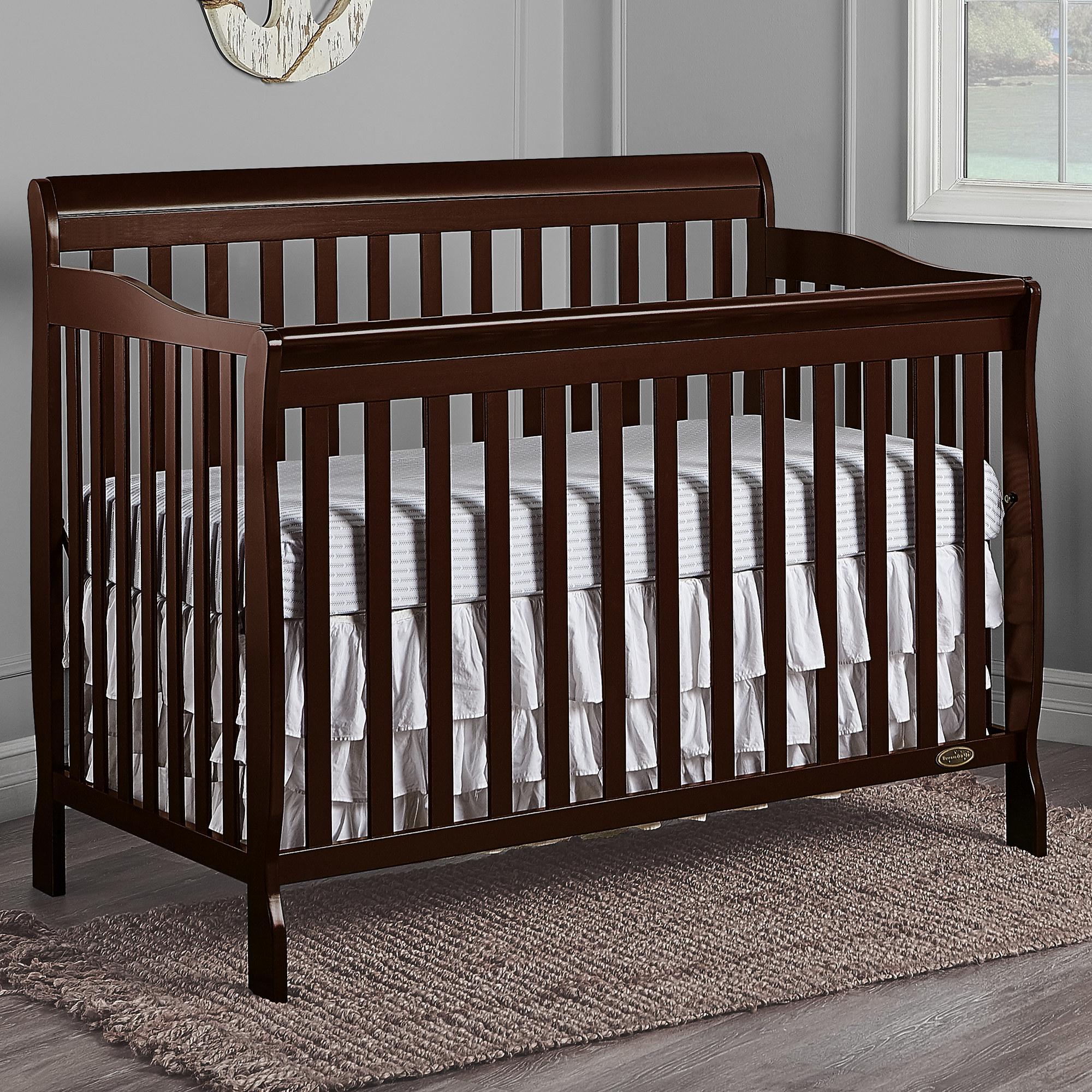 Dark brown convertible crib in a nursery