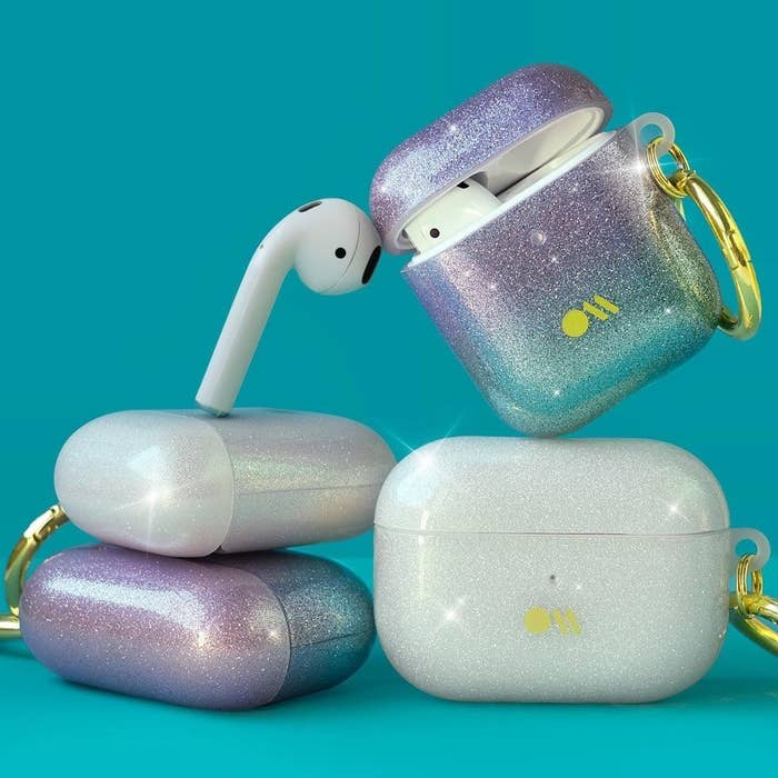 The Air Pod cases in glittery shades of purple and white