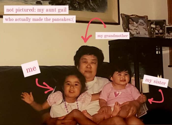 """The writer as a child with her younger sister sitting on their grandmother's lap with a note, """"Not pictured: My Aunt Gail who actually made the pancakes"""""""