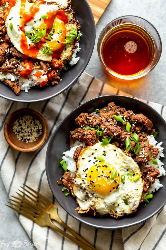 A Korean ground beef bowl topped with a fried egg and scallions.