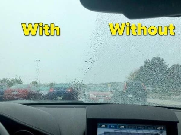 A reviewer's car window with the treatment on it on one side, and not on the other — the side with the treatment is clearer to see out of while it's raining outside