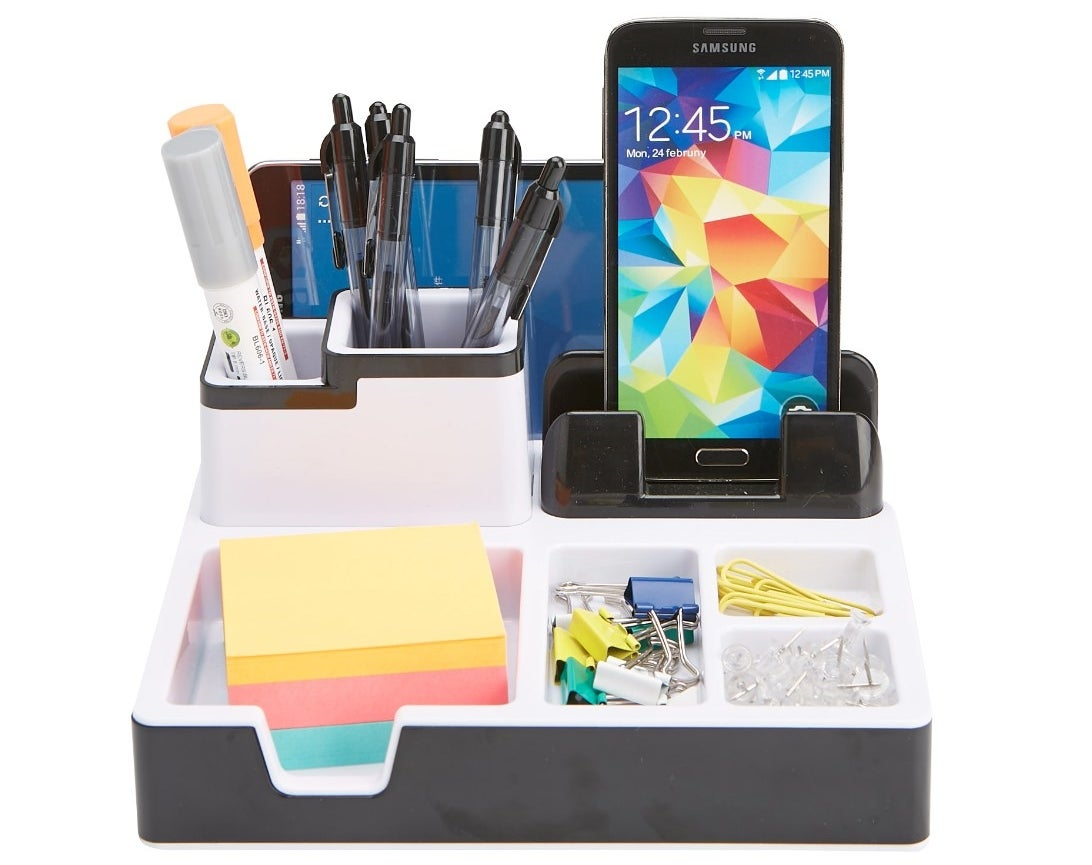 The organizer being used to hold pens, post its, and other office supplies