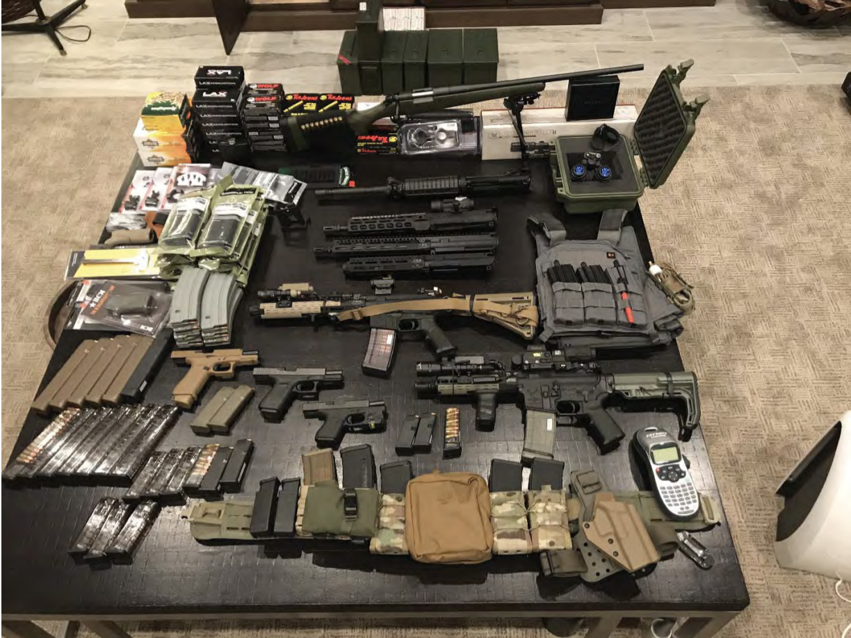 Guns and ammunition laid out across a table