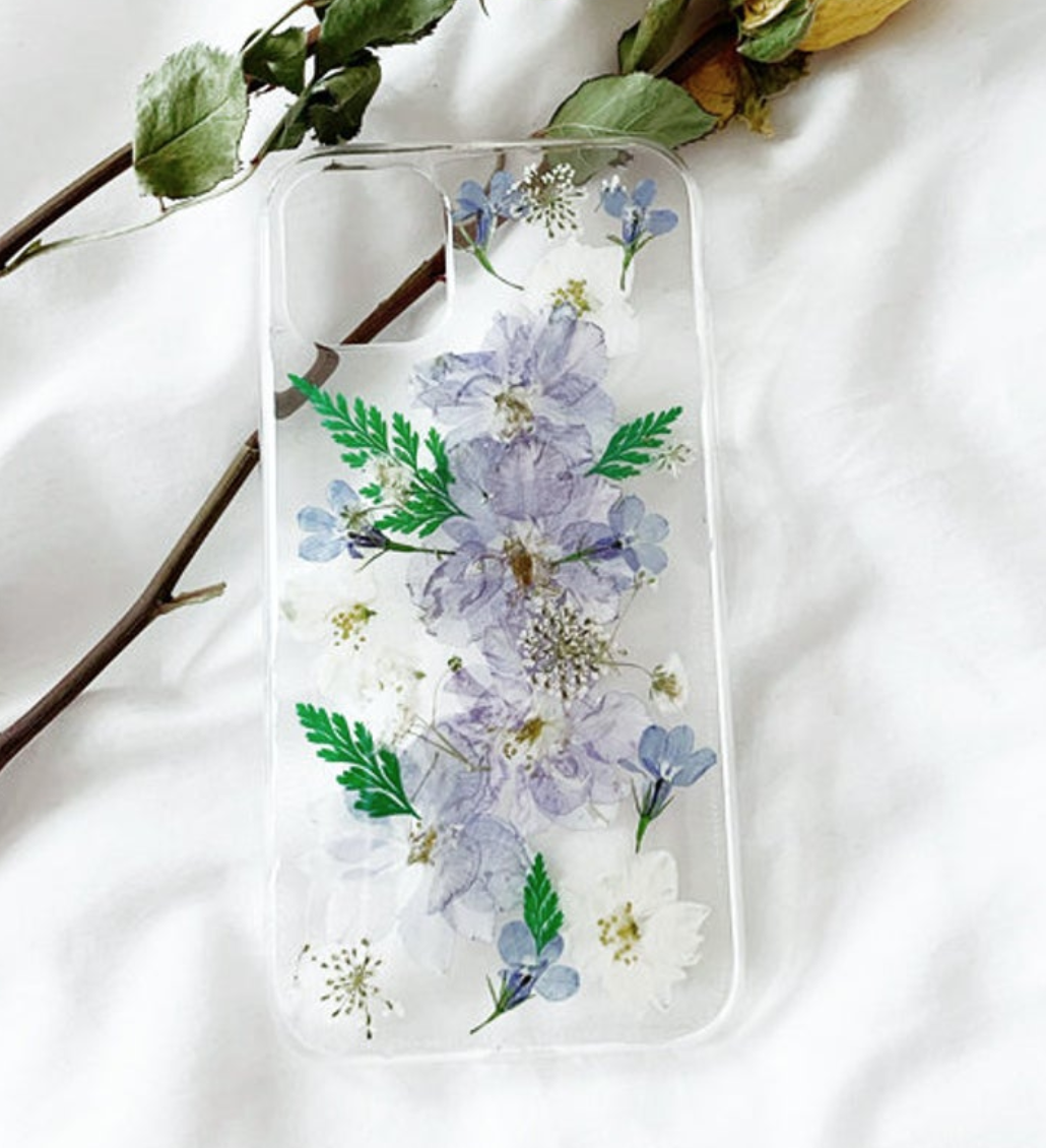 Clear phone case with purple and white dried flowers and leaves