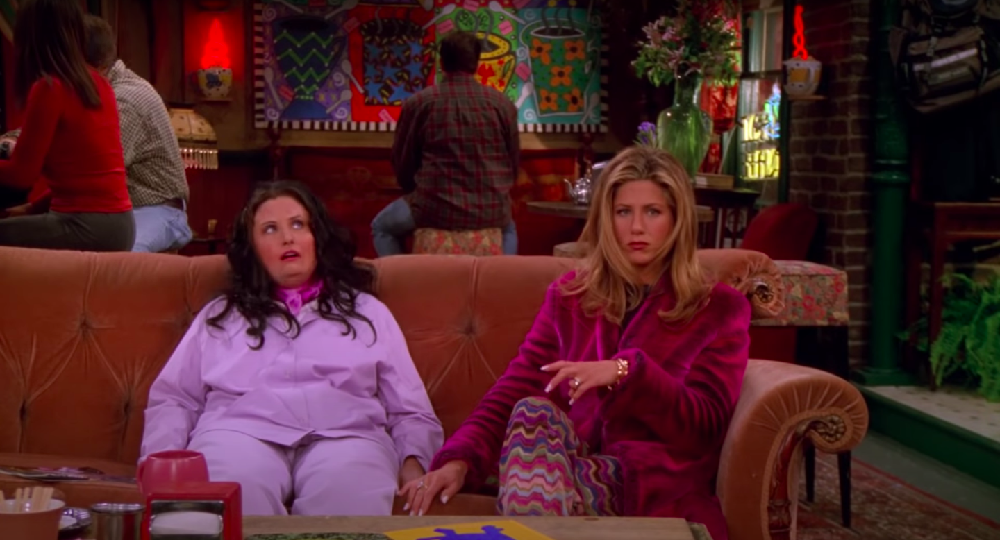 """Alternate-universe """"Fat Monica"""" and Rachel, married to Barry, sit on the Central Perk couch"""