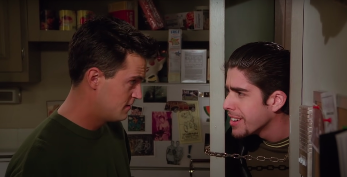 Chandler and Eddie, his roommate, argue at the door to Chandler and Joey's apartment