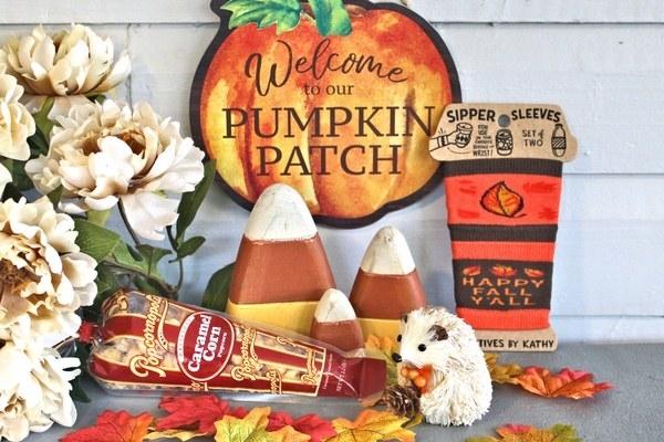 various fall items like caramel corn, candy corn figures, and a hedgehog