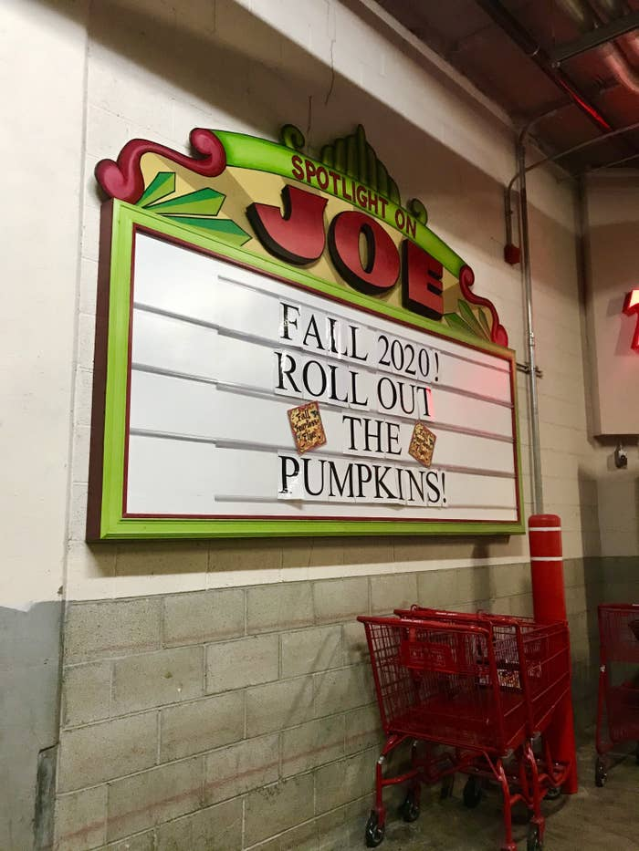 """A sign outside of Trader Joe's that says """"Fall 2020! Roll out the pumpkins!"""""""