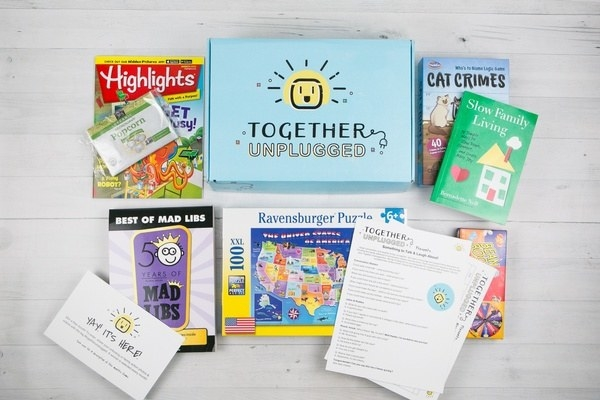 the Together Unplugged Box with books, magazines, puzzles and other activities unpacked