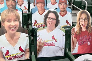 Pam, Phyllis, and Erin from The Office as cardboard cutouts at a major league baseball game