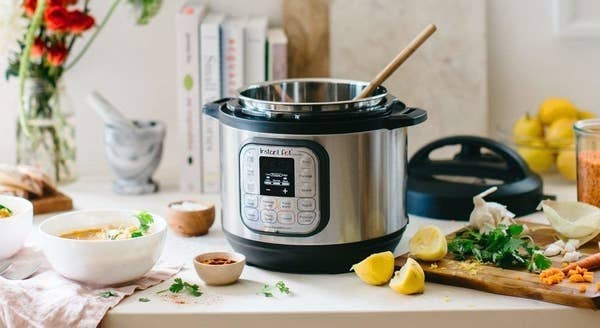 The Instant Pot on a counter surrounded by various ingredients