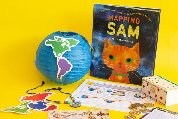 a book, a lantern in the shape of a globe, and other activities for children