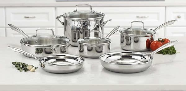 The stainless steel cookware set feauring various sizes of pots and pans with lids