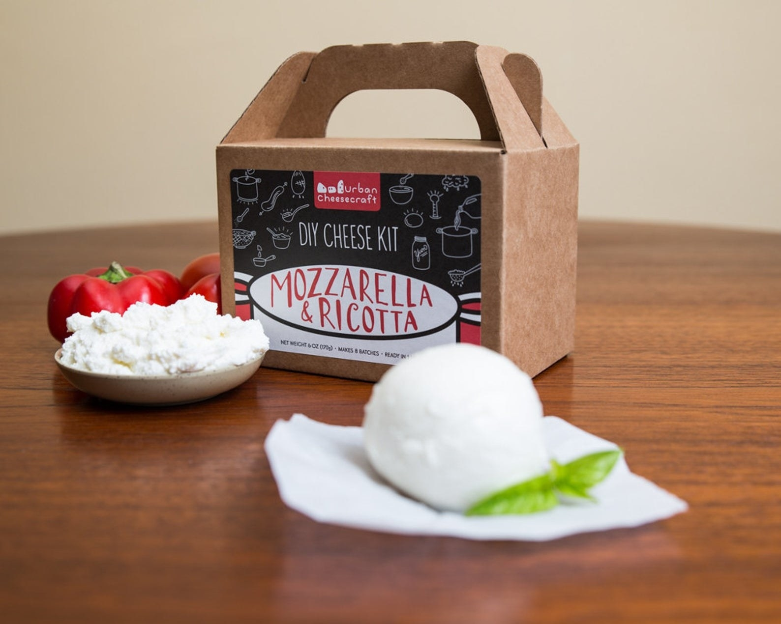 The kit with a ball of mozzarella and a plate of ricotta
