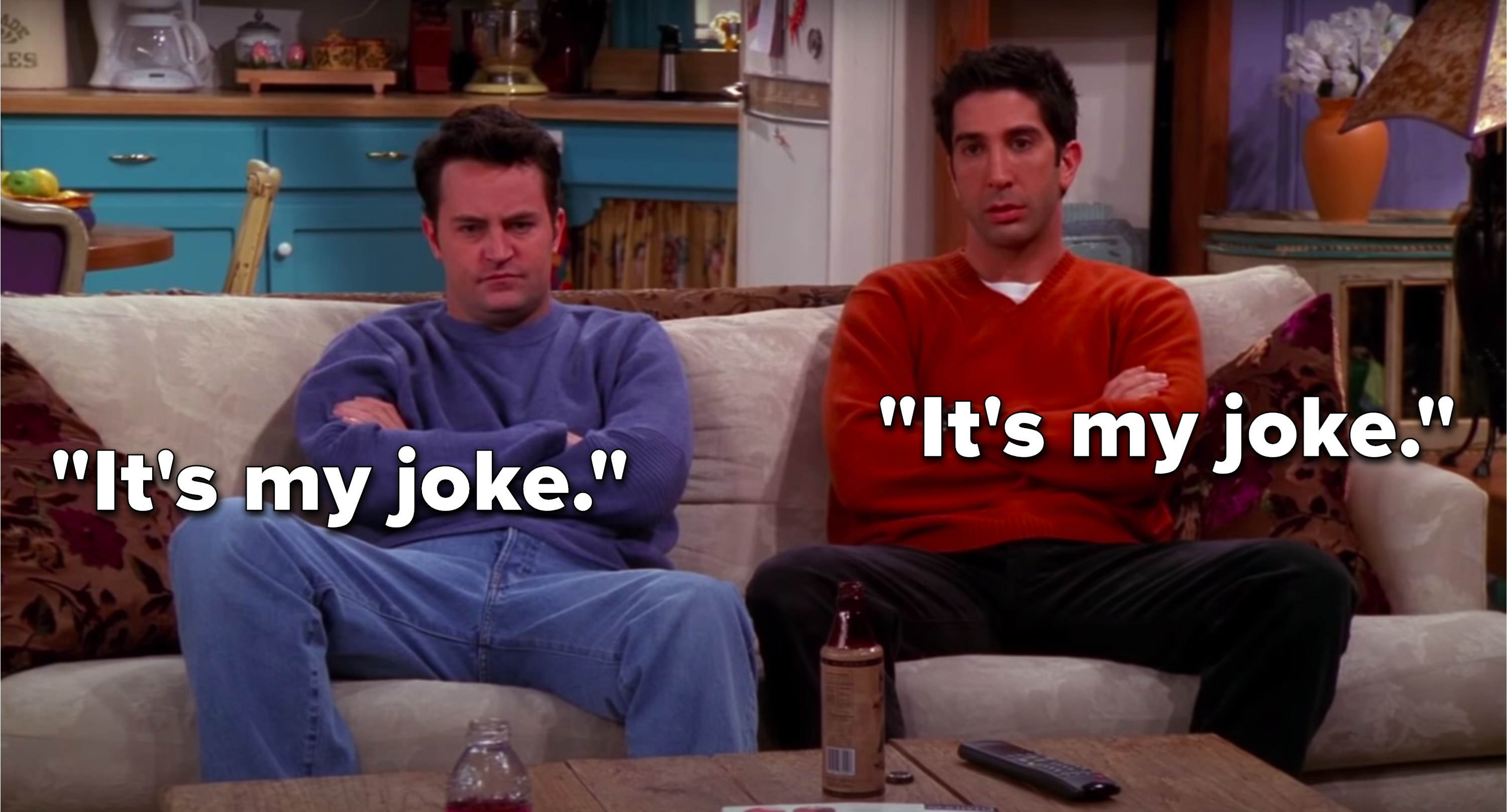 """Chandler and Ross, both angry on Monica and Chandler's couch, tell each other, """"it's my joke"""""""