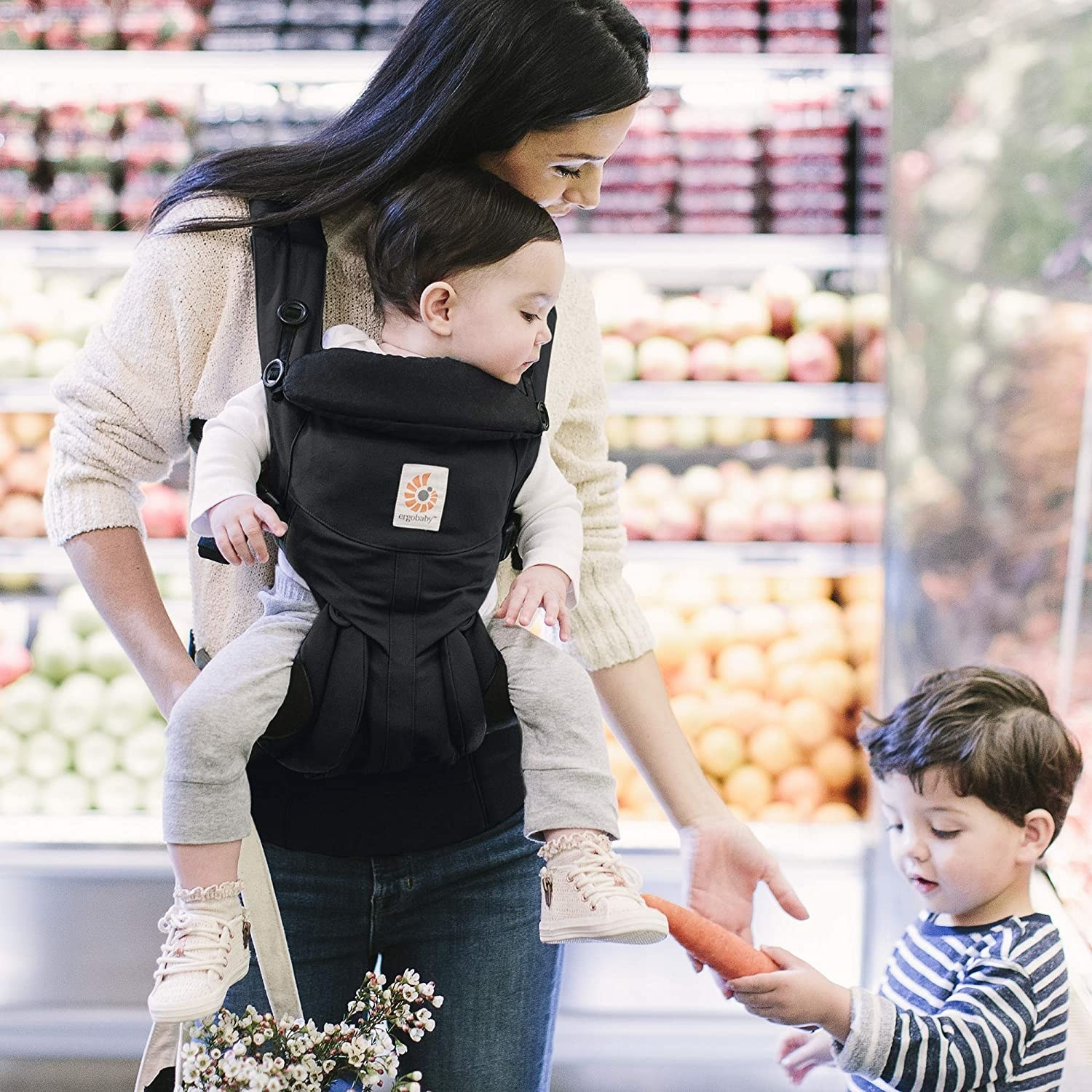Woman holding a baby in the baby carrier