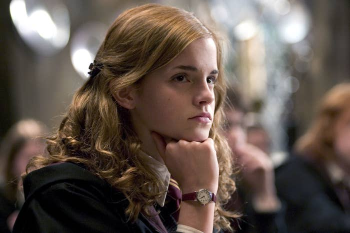 Hermione leaning her head onto her hand