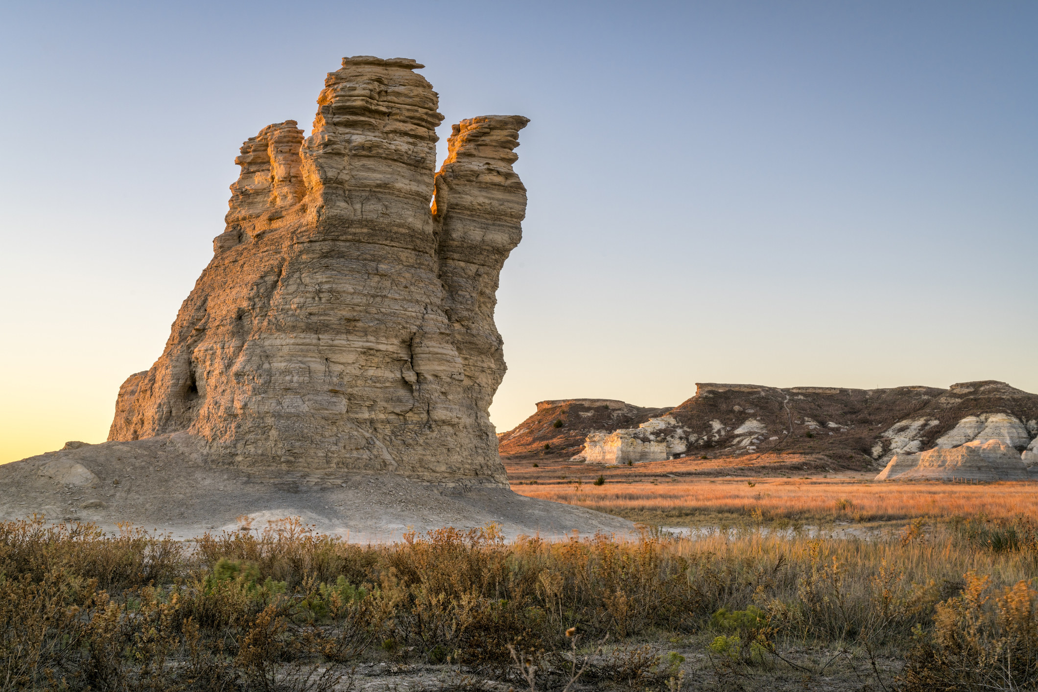 Castle Rock limestone pillar in a prairie of western Kansas at sunrise