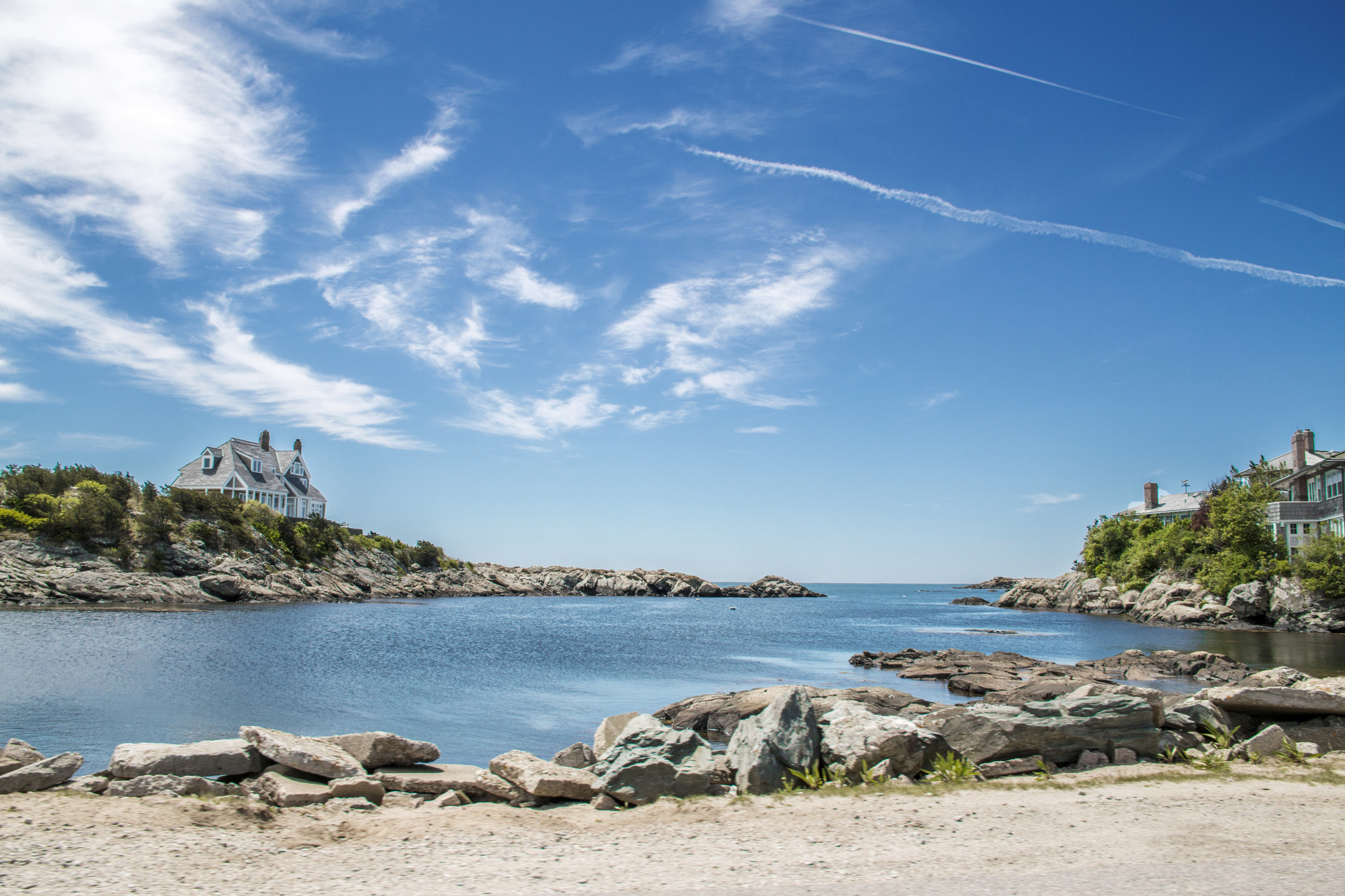 A picture of the blue sky over an ocean inlet in Newport, Rhode Island
