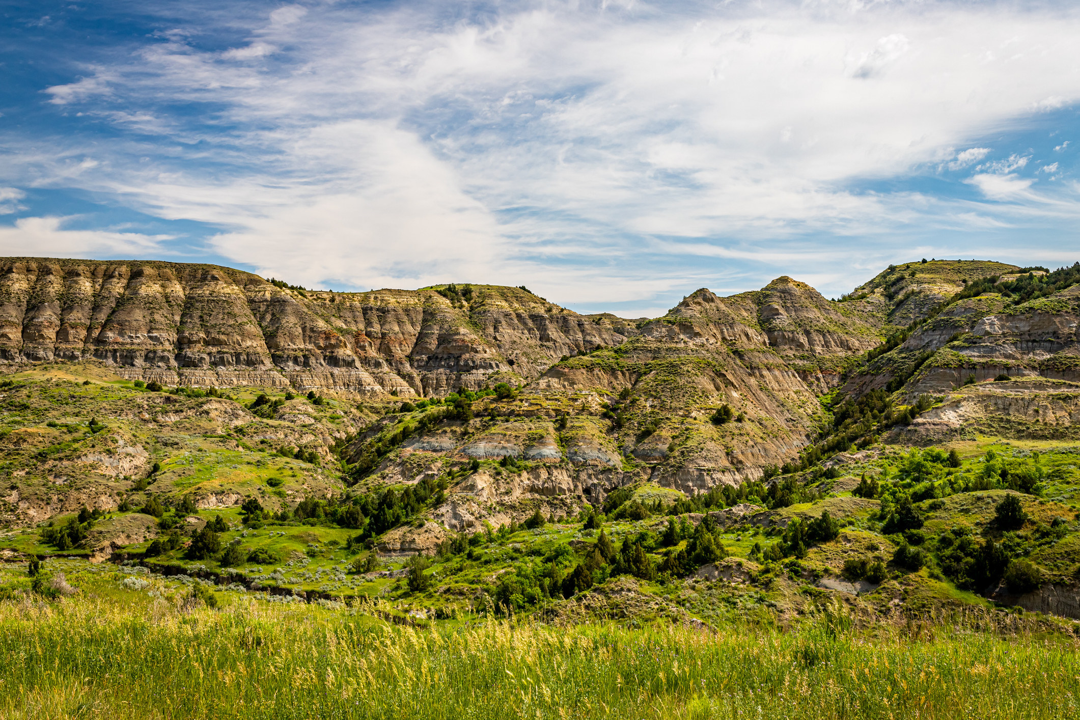 Scenic view of rocky hills covered with greenery along Theodore Roosevelt Expressway in western North Dakota