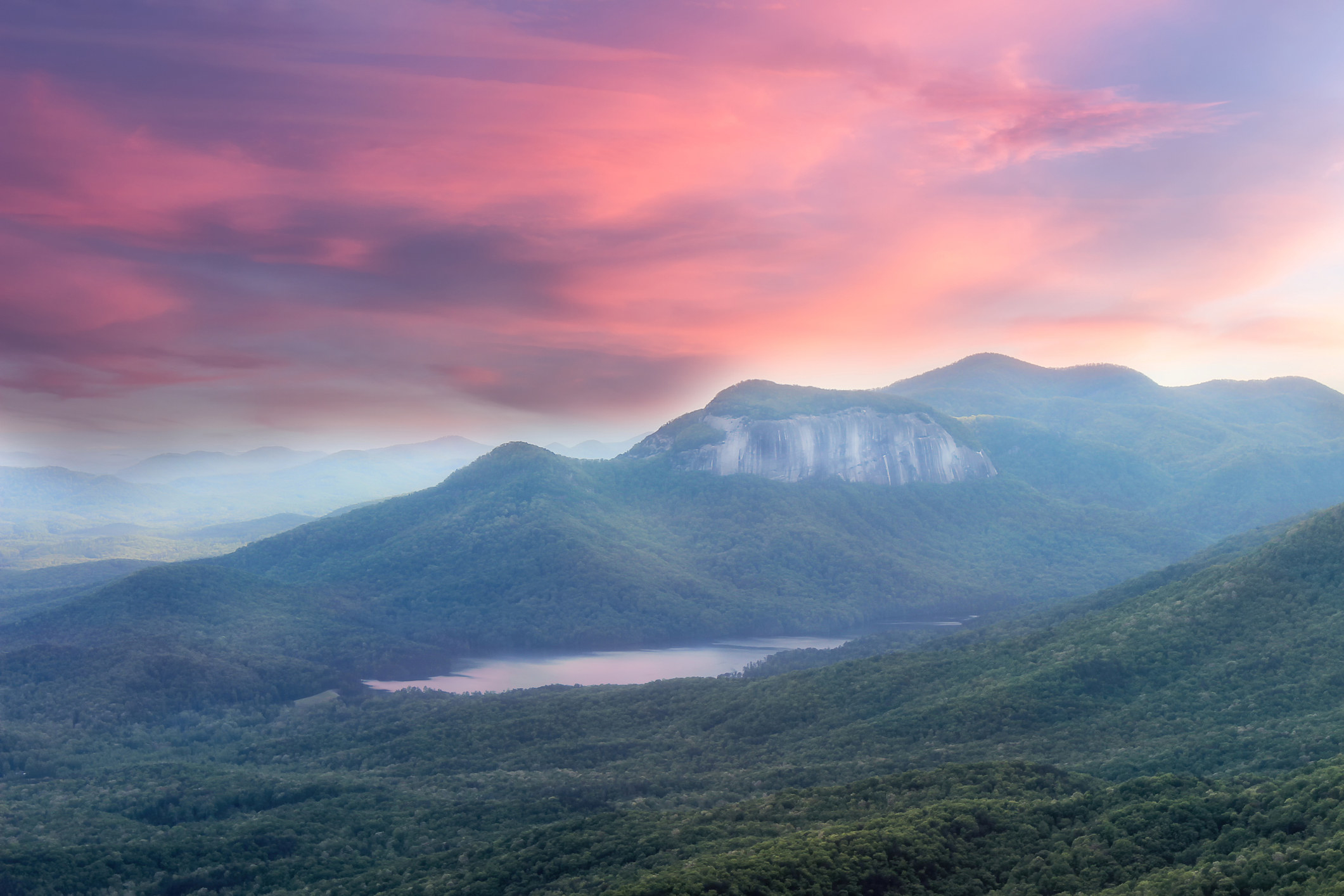 Soft, dreamy sunset view from Caesar's head overlook on Table Rock Mountain and Lake