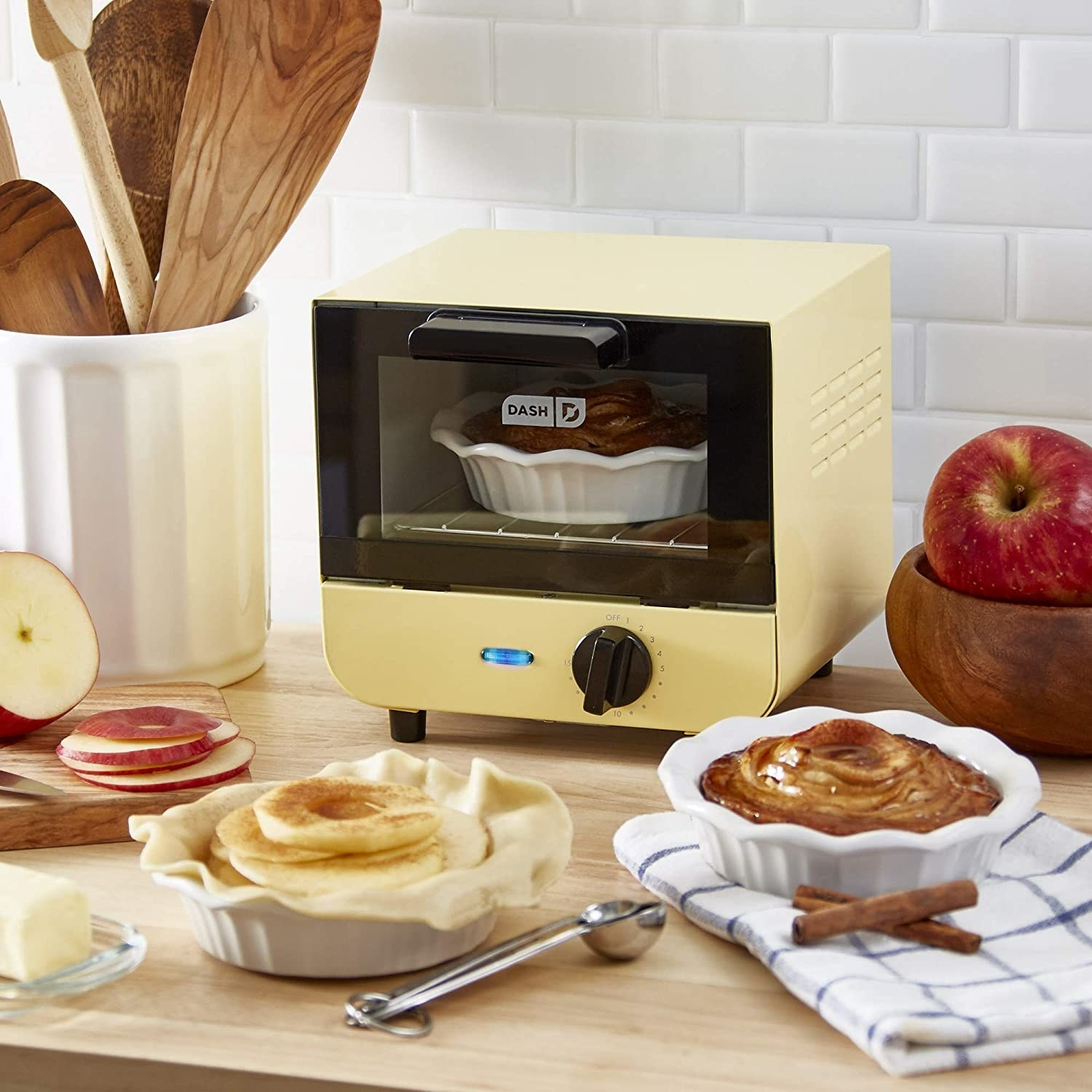 A small toaster oven with a pie cooking in it