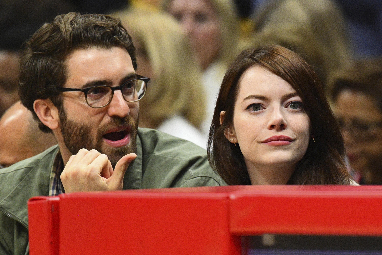 Dave explaining something to Emma at a basketball game