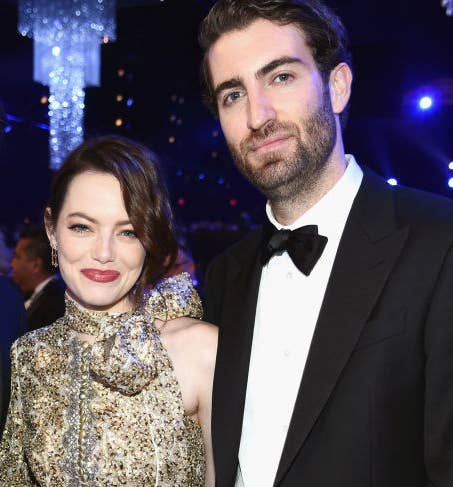 Emma and Dave posing for a photo at an award show