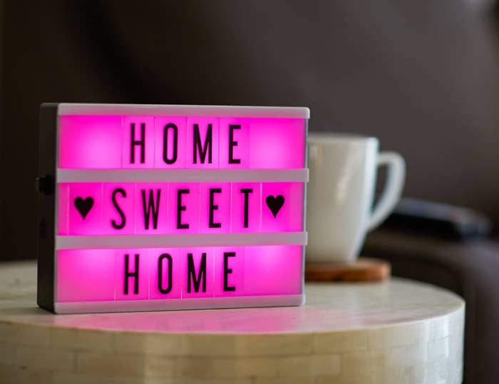 A lightbox with a pink light that says home sweet home