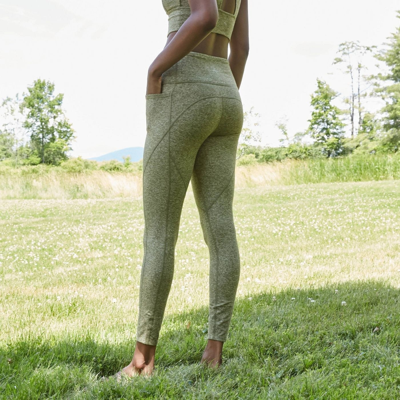 Model wearing the heather green leggings