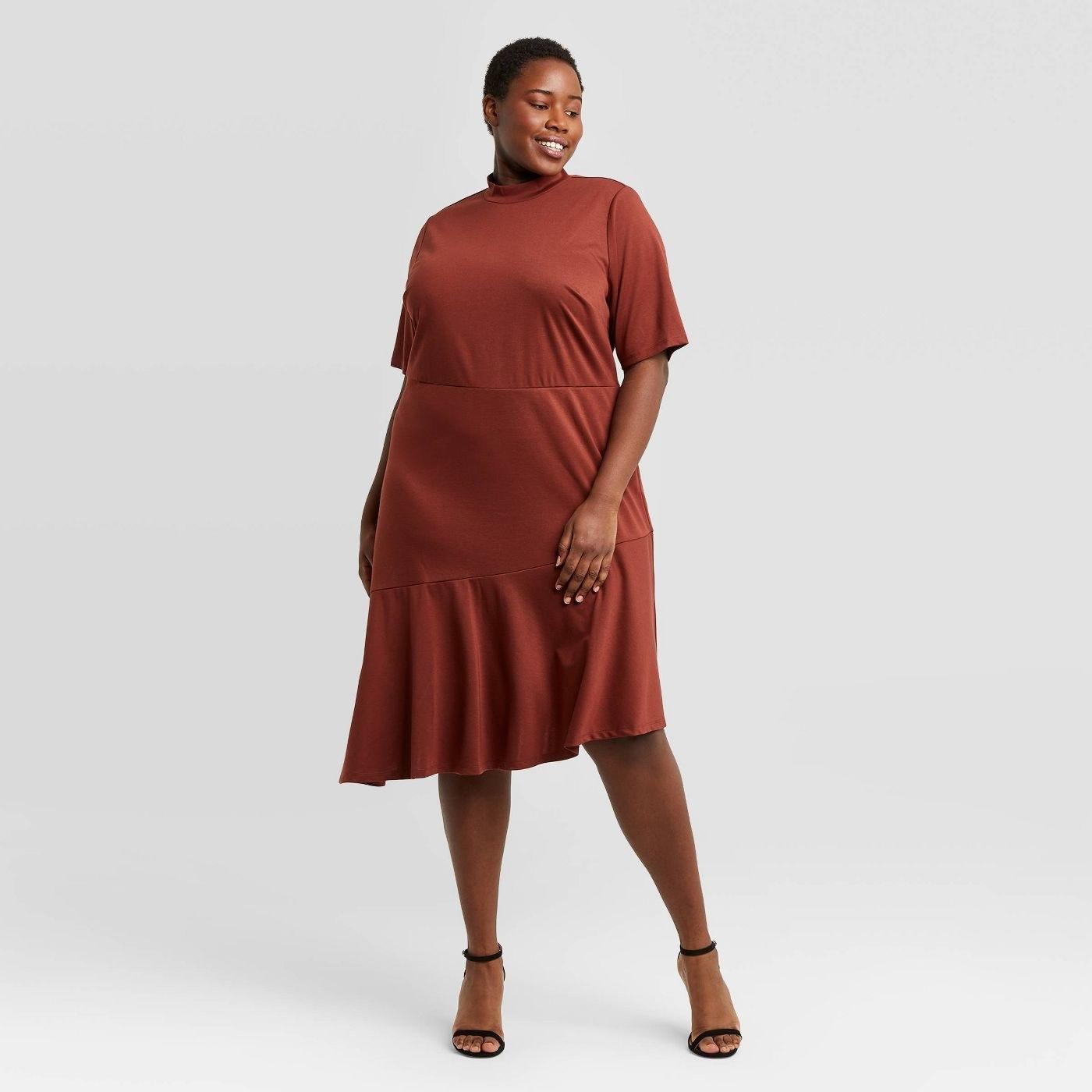 Model wearing the maroon dress