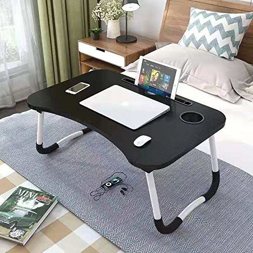A lap desk with things on it