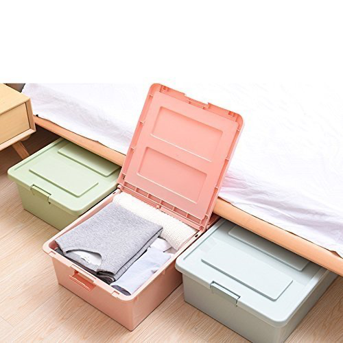 A few rectangular storage boxes under a bed