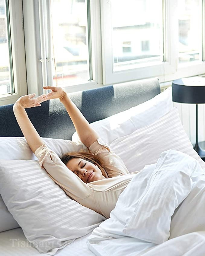 Woman stretching in bed.
