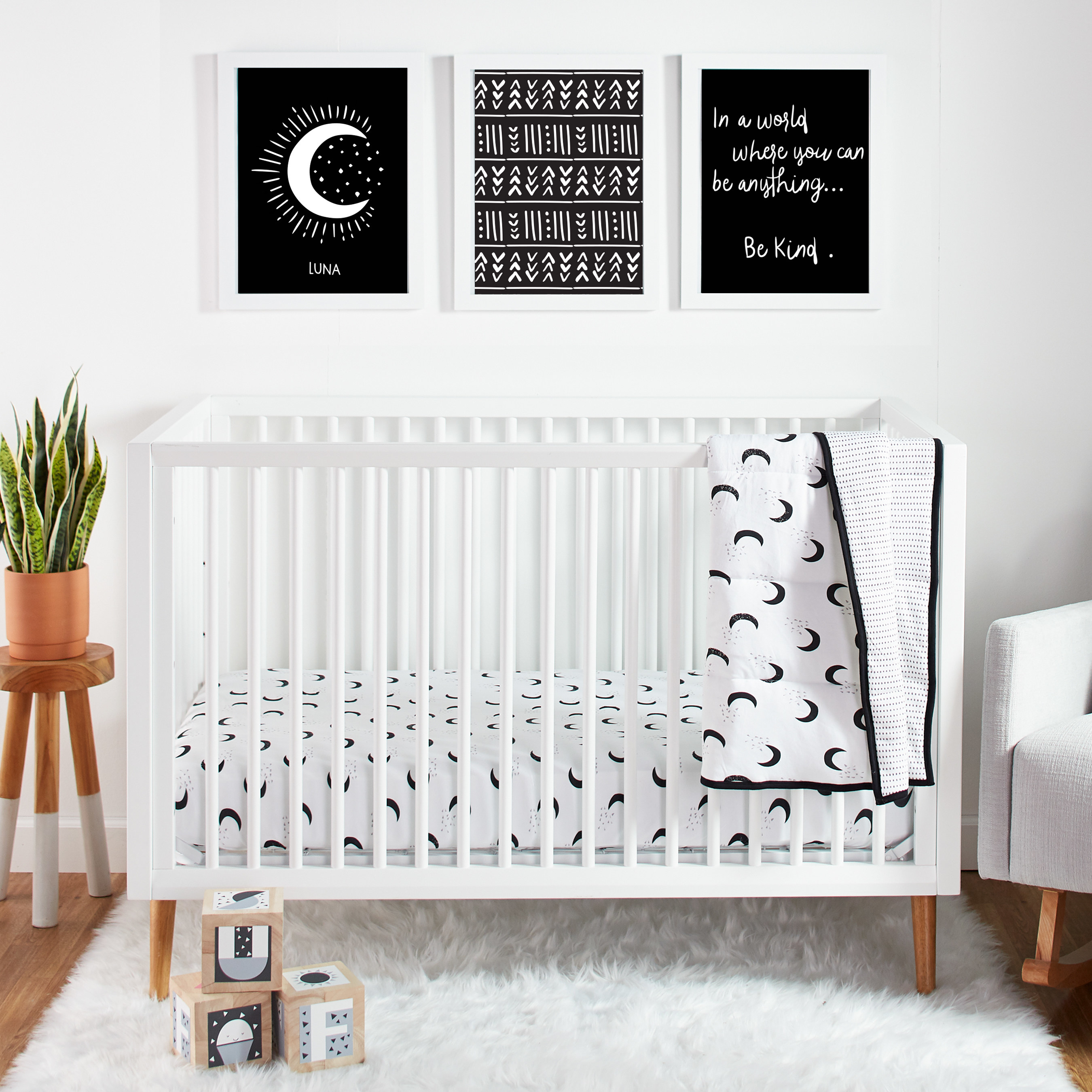 The black and white moon patterned set on a crib