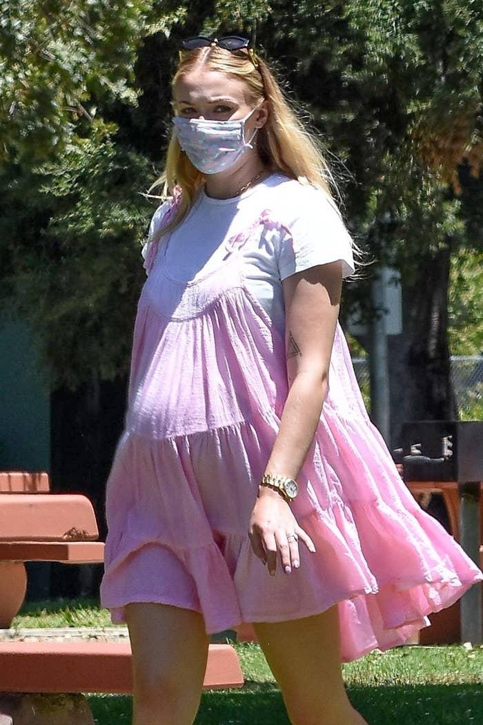 Sophie wearing a pink babydoll dress