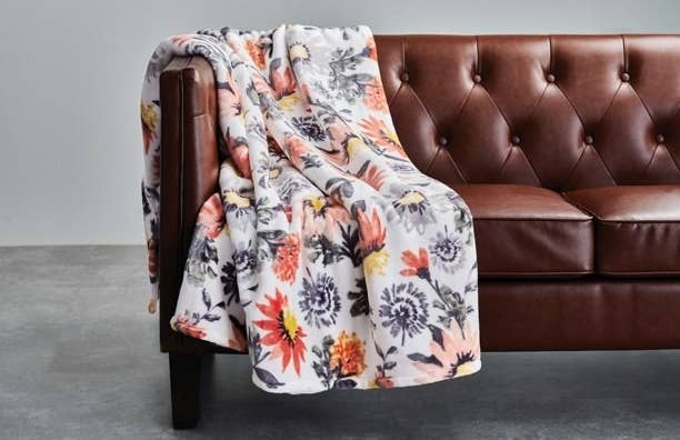 The floral blanket on couch