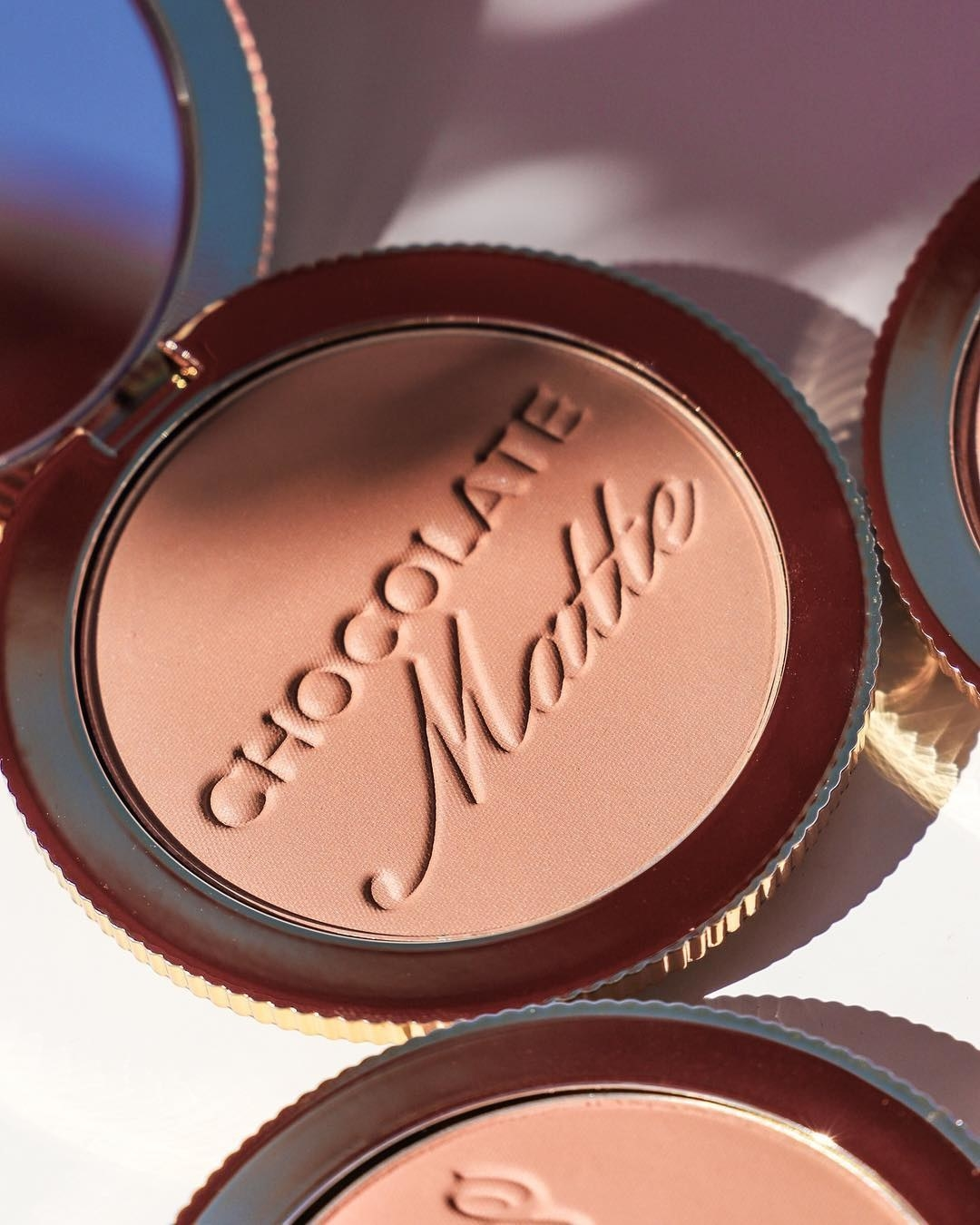 An open bronzer that says chocolate matte