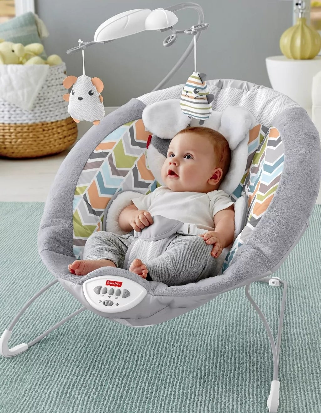 The baby bouncer with a mobile