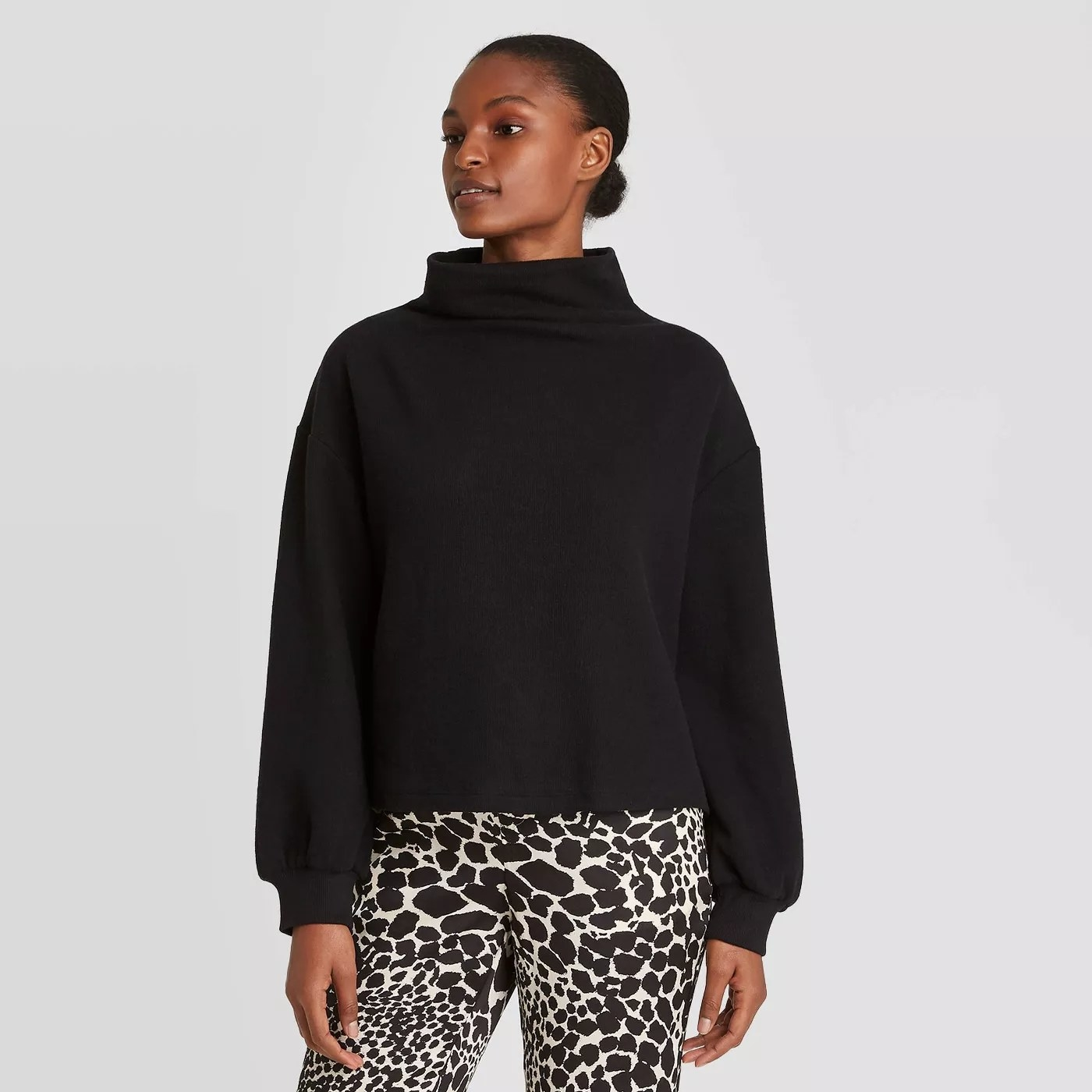 The black sweater with a high neck