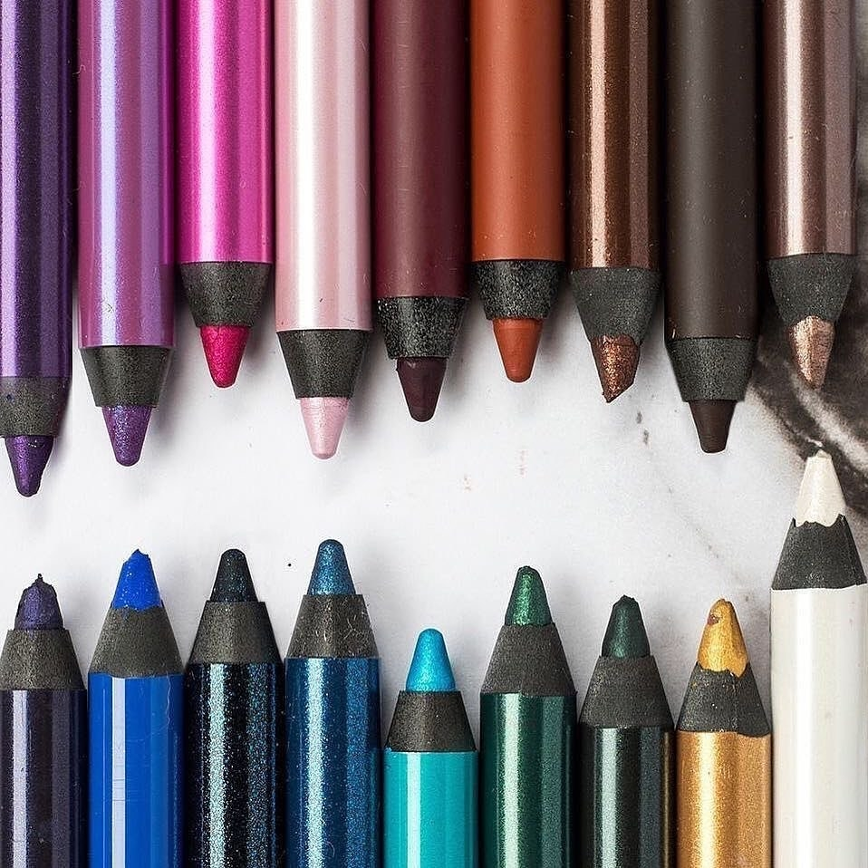 A variety of eyeliner colours opened and sharpened