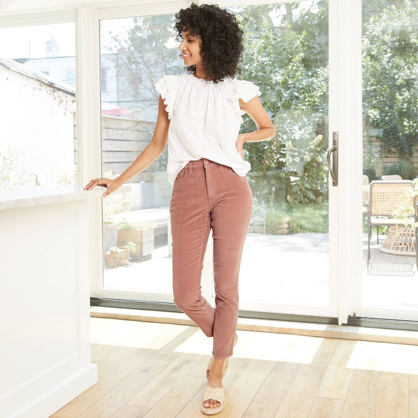 Model wearing the pink skinny jeans