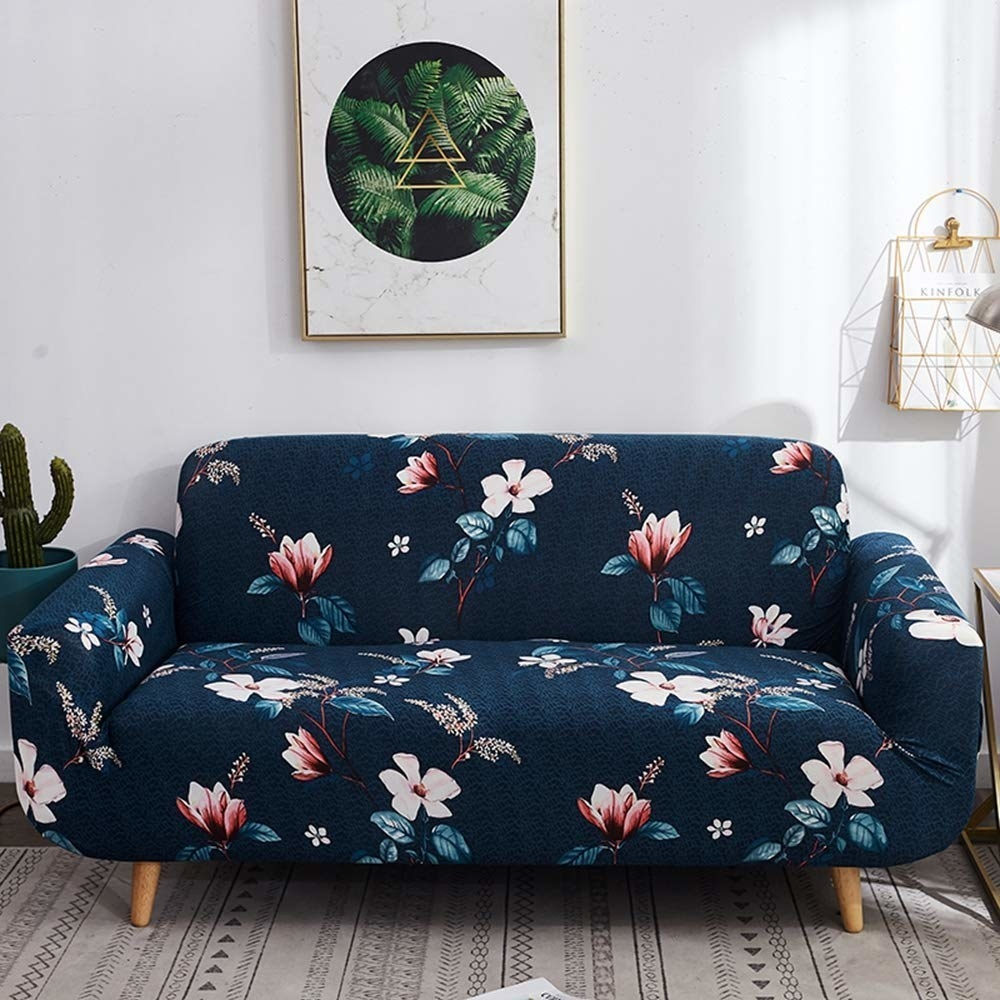 A blue sofa cover with flowers
