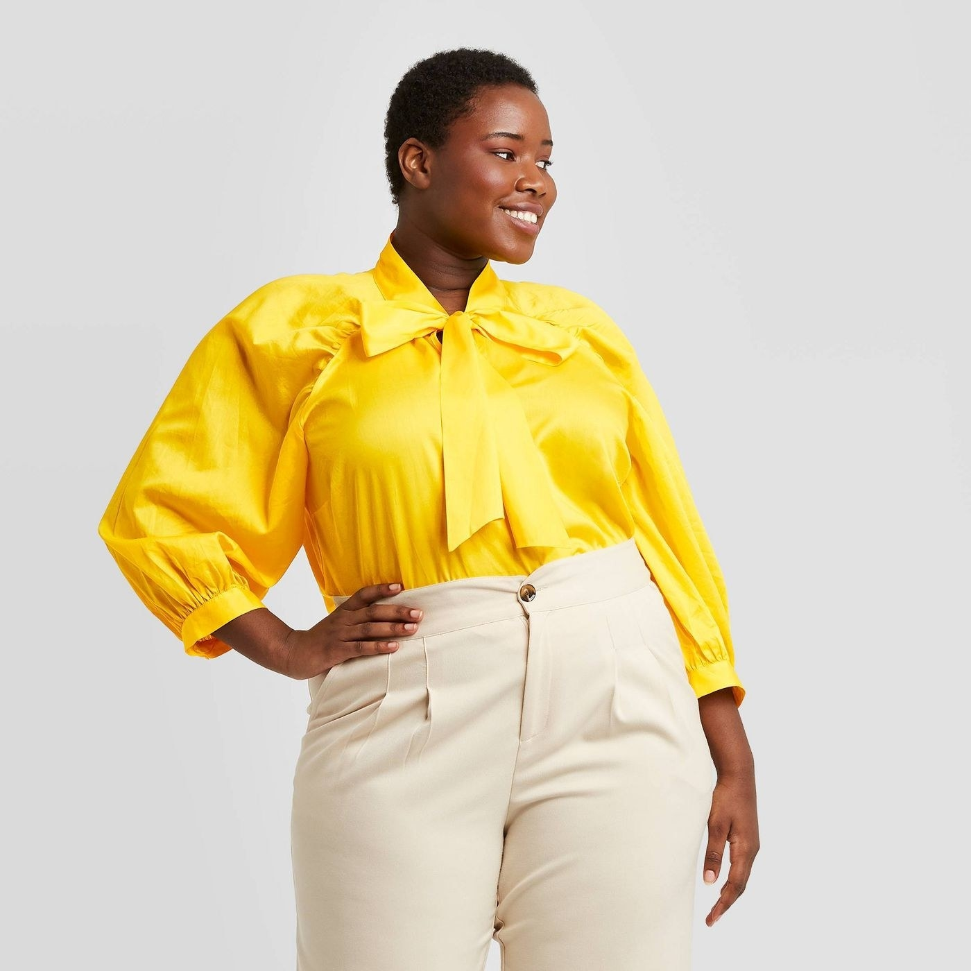 Model wearing the yellow blouse