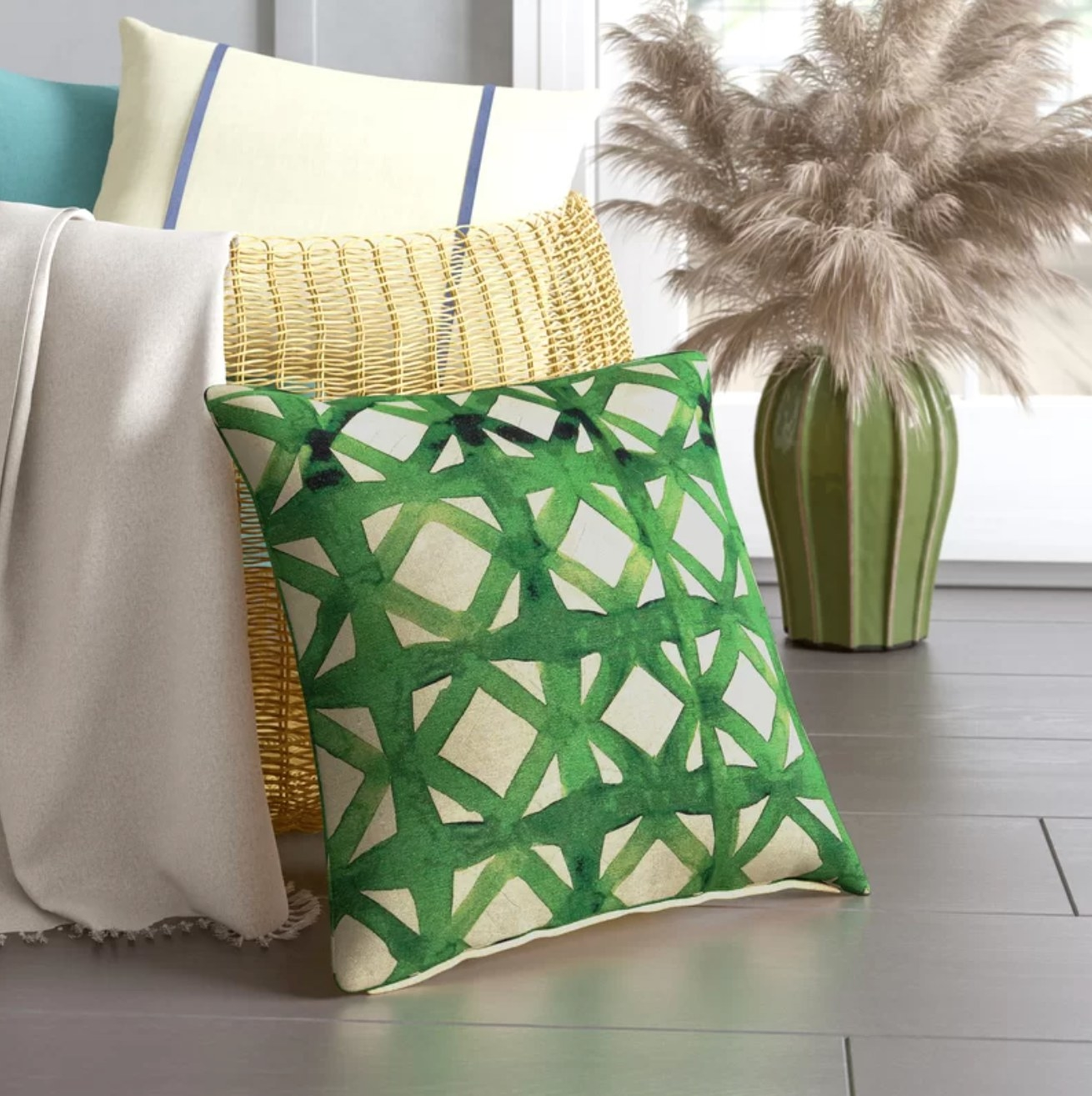 ivory throw pillow with green watercolor line design