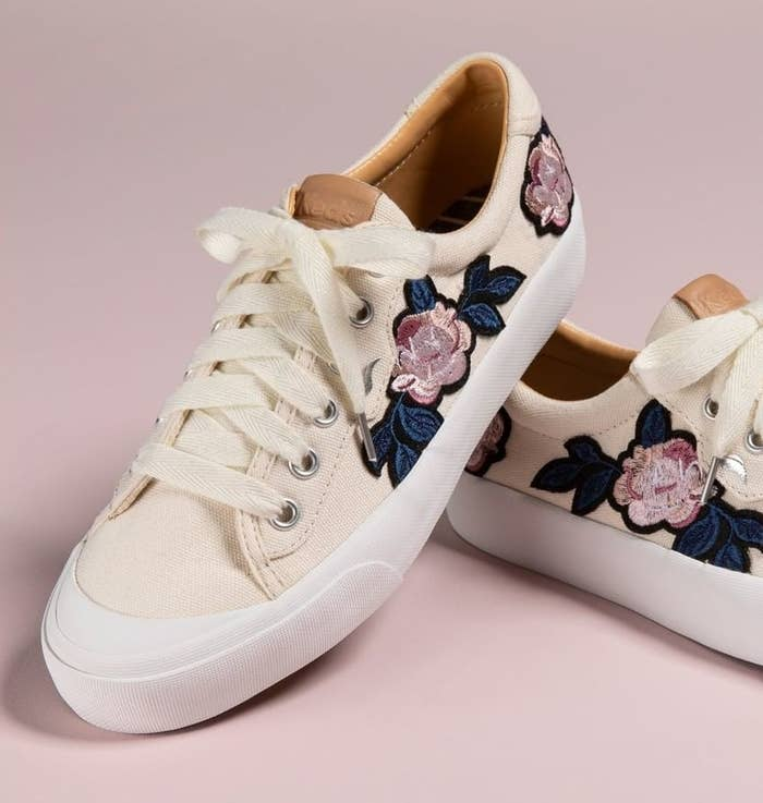 A pair of embroidered Keds