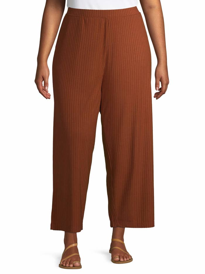 Model wears rib knit pants in cinnamon spice